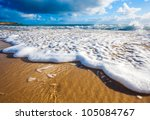 waves wash over golden sand on... | Shutterstock . vector #105084767