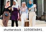 group of islamic girls using... | Shutterstock . vector #1050856841