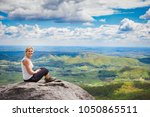 beautiful mid 30s hiker woman... | Shutterstock . vector #1050865511