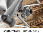 drone isolated on a wood... | Shutterstock . vector #1050874319
