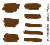 set of hand painted brown brush ... | Shutterstock .eps vector #1050879389