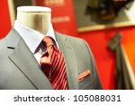 man's business suit shirt and necktie on mannequin in shop window - stock photo