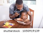 the housekeeper in a black... | Shutterstock . vector #1050919139