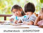 group of asian children drawing ...   Shutterstock . vector #1050937049