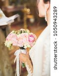 bride holding big and beautiful ... | Shutterstock . vector #1050943289