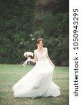 beautiful bride in elegant... | Shutterstock . vector #1050943295