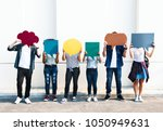 young adult friends holding up... | Shutterstock . vector #1050949631