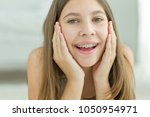 girl with braces | Shutterstock . vector #1050954971