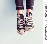 woman wear black sneaker shoes | Shutterstock . vector #1050970064