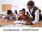 teacher helping african...   Shutterstock . vector #1050970169