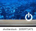 power button icon over modern... | Shutterstock . vector #1050971471