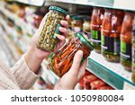 buyer hands with a can of... | Shutterstock . vector #1050980084