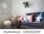 corner in the nursery. sofa... | Shutterstock . vector #1051021544