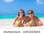 couple lying on a tropical... | Shutterstock . vector #1051023641