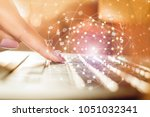 business woman hand typing on... | Shutterstock . vector #1051032341