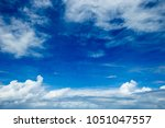 blue sky background with tiny... | Shutterstock . vector #1051047557