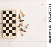 wooden chess figures and chess... | Shutterstock . vector #1051052081