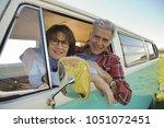 portrait of cheerful senior... | Shutterstock . vector #1051072451