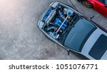 top view super car engine open... | Shutterstock . vector #1051076771