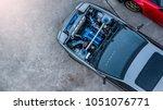 top view super car engine open... | Shutterstock . vector #1051076771