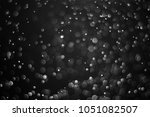 black bokeh  abstract black... | Shutterstock . vector #1051082507