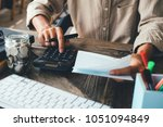 asian man working with... | Shutterstock . vector #1051094849