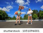 two teenage girls playing... | Shutterstock . vector #1051096001