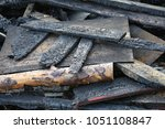 burned cabin house after fire... | Shutterstock . vector #1051108847