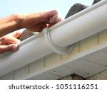 contractor installing plastic...   Shutterstock . vector #1051116251