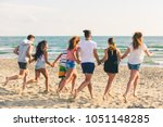 multiracial group of friends... | Shutterstock . vector #1051148285