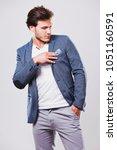 fashion portrait of a handsome... | Shutterstock . vector #1051160591