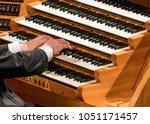 hand of organist playing on... | Shutterstock . vector #1051171457