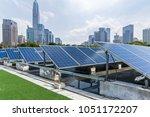 solar and modern city skyline | Shutterstock . vector #1051172207