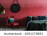 Burgundy bedroom interior with...