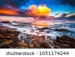 sunset clouds ocean beach waves ... | Shutterstock . vector #1051174244