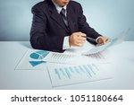 business man point a document... | Shutterstock . vector #1051180664