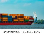 red container ship. logistics...   Shutterstock . vector #1051181147