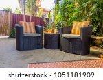 rattan sofa at the back yard   Shutterstock . vector #1051181909