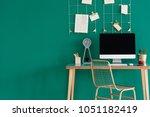computer on a wooden desk ...   Shutterstock . vector #1051182419