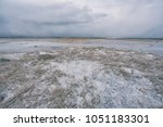 the first ice in the dunes of... | Shutterstock . vector #1051183301