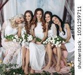 charming women sit side by side ... | Shutterstock . vector #1051259711