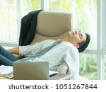 young asian businessman tired...   Shutterstock . vector #1051267844