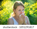 woman suffering from pollen... | Shutterstock . vector #1051291817