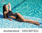 beautiful and sexy girl in a... | Shutterstock . vector #1051307321