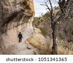 boy walking on trail at gila... | Shutterstock . vector #1051341365