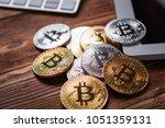 gold bitcoin on modern mobile... | Shutterstock . vector #1051359131