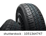 new and unused car tires... | Shutterstock . vector #1051364747