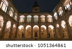 The Archiginnasio atrium at night. It houses now the Municipal Library and the famous Anatomical Theatre. Bologna, Italy.