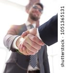Small photo of business leader shaking hands with partner.