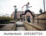 freerunner is jumping between... | Shutterstock . vector #1051367714